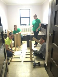 Member's of JLE volunteering to update a client room for transitional housing at the YWCA